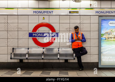 A London Underground Worker At Monument Tube Station, London, England - Stock Photo