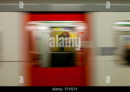 A Train Arrives At An Underground Station, The London Underground, London, England - Stock Photo