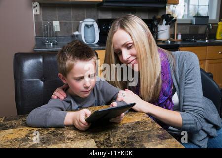 Canada,Kitchen,Mother,Digital Tablet,Boy - Stock Photo