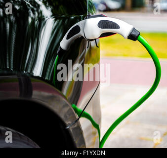 Electric car charging in EV charging station - Stock Photo