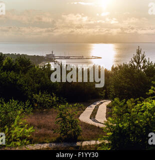 Sunrise over the Curonian Lagoon in Nida resort town - Stock Photo