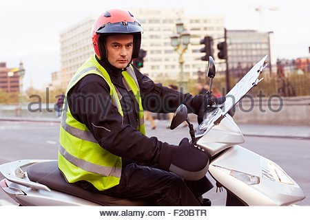 Motor scooter rider in London, undertaking taxi driver training 'the knowledge' - Stock Photo
