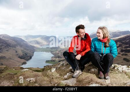 Young couple on hilltop, Honister Slate Mine,  Buttermere, Crummock Water, Keswick, Lake District, Cumbria, United - Stock Photo