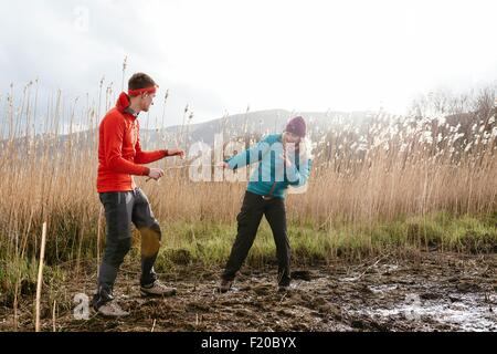 Young couple hiking, fooling around, Derwent Water, Keswick, Lake District, Cumbria, United Kingdom - Stock Photo