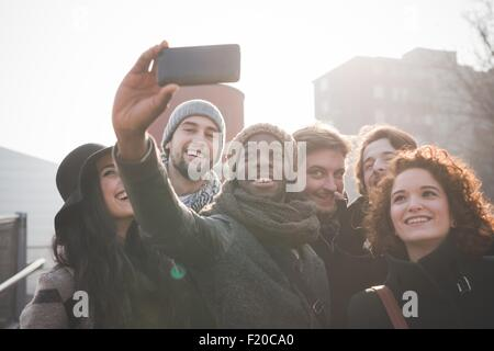Six young adult friends taking smartphone selfie - Stock Photo