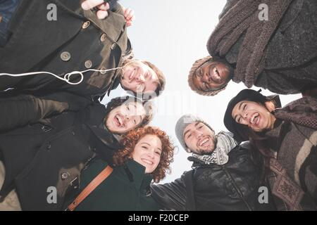 Low angle portrait of six young adult friends - Stock Photo