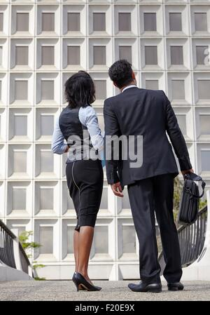 Low angle full length view of business people, looking up