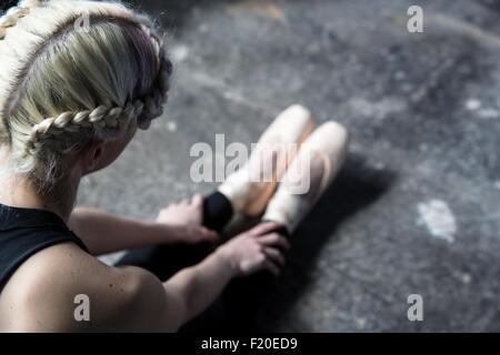 Dancer stretching in studio - Stock Photo