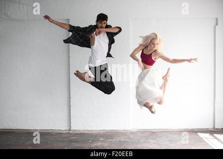 Dancers practising in studio - Stock Photo
