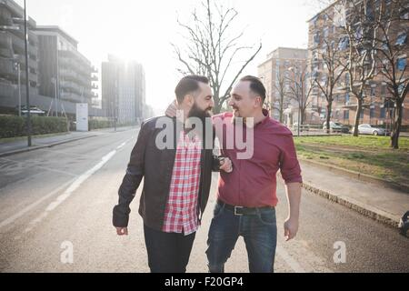 Gay couple walking on street - Stock Photo