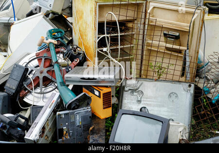 pile of discarded electrical junk - Stock Photo