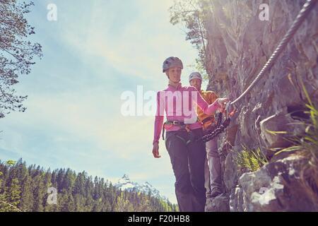 Couple rock climbing, Ehrwald, Tyrol, Austria - Stock Photo