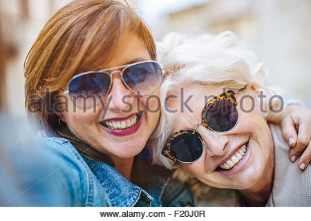 Two mature women posing for selfie - Stock Photo