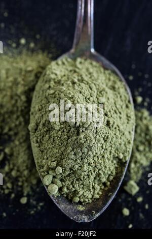 Spoon of green matcha tea powder. - Stock Photo