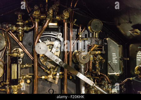 Great Western Railway steam engine complex footplate. Museum Swindon England. - Stock Photo
