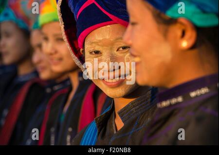 Myanmar (Burma), Shan state, Pao's tribe, Kakku, young Pao girls wearing traditional costume during Kakku's pagoda - Stock Photo