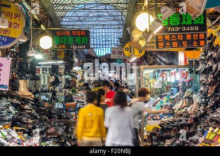 South Korea, Seoul, Jongno-gu, Dongdaemun market opened in 1905, shoe salesmen