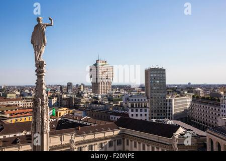 Italy, Lombardy, Milan, one arrow and statue of Duomo seen since the terrace situated on the roof of the cathedral - Stock Photo