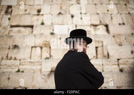 Israel, Jerusalem, Orthodox jew praying at the Wailing Wall - Stock Photo