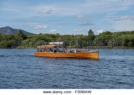 The Lady Derwentwater pleasure motor boat with passengers on Derwent Water near Keswick, Cumbria in the Lake District - Stock Photo