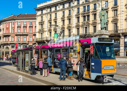 Italy, Lombardy, Milan, Piazza Cordusio, tram to the bottom with the statue of the Italian poet Giuseppe Parini - Stock Photo