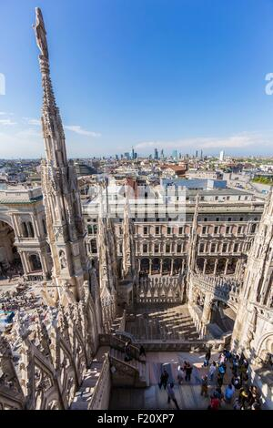 Italy, Lombardy, Milan, the arrows and statues of Duomo seen since the terrace situated on the roof of the cathedral - Stock Photo