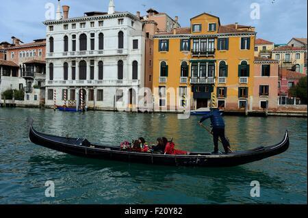 Italy, Veneto, Venice, listed as World Heritage by UNESCO, gondolo on the Canal Grande, Academia bridge - Stock Photo