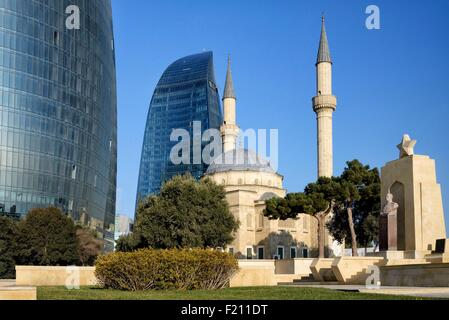 Azerbaijan, Baku, Martyrs' Lane (Alley of Martyrs), small mosque and the Flame Towers - Stock Photo