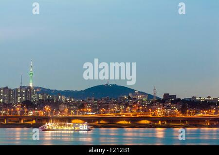 South Korea, Seoul, Banpo Bridge view from the Han River and Namsan Park in the background and telecommunications - Stock Photo