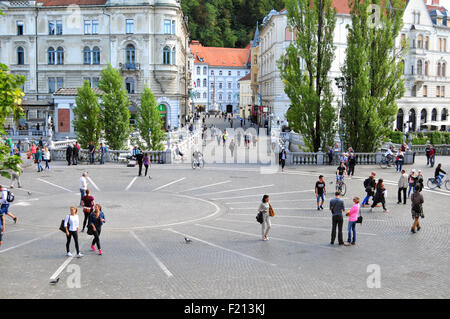 Ljubljana, Slovenia - September 7, 2015 - Presern square and people going by with  their usual everyday business - Stock Photo