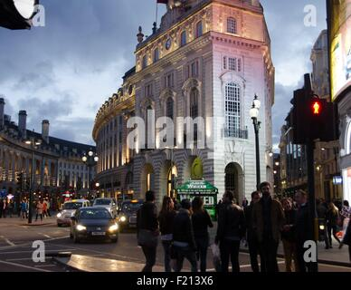 Busy spring evening traffic in Piccadilly Circus, London, UK. - Stock Photo