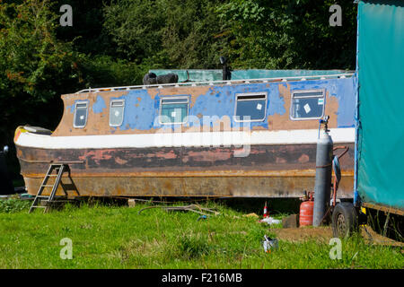 Narrowboat in Dry Dock Undergoing Repair Work, Stourbridge Canal, Staffordshire, England, UK - Stock Photo