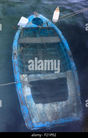 Sunken fishing boat in the harbor of Finiki, Karpathos, Dodecanese, Greece - Stock Photo