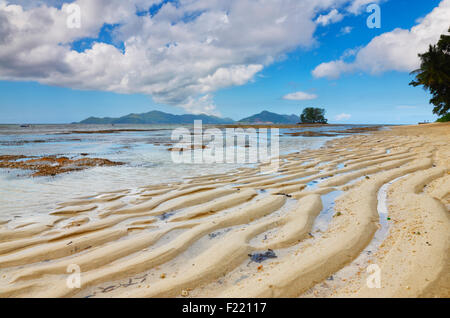 Sand dune on the beach, island La Digue, Seychelles. - Stock Photo