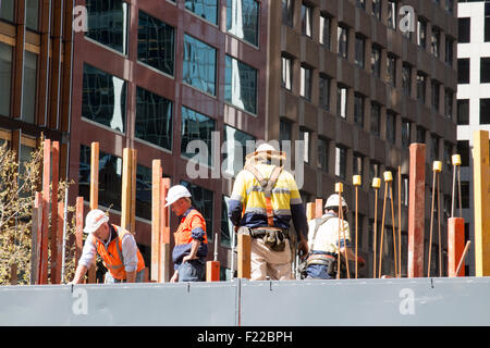 workers on a construction site in Sydney city centre,new south wales,australia - Stock Photo