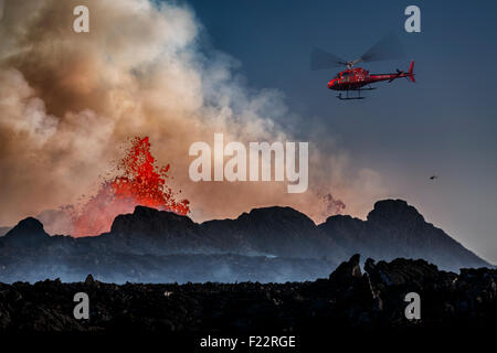 Helicopter flying over the volcano eruption at the Holuhruan Fissure, Bardarbunga - Stock Photo