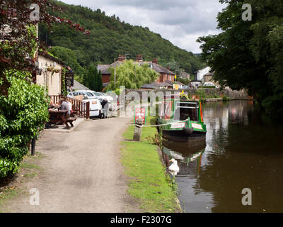 Towpath and Hebden Bridge Cruises Narrowboat on the Rochdale Canal at Stubbing Wharf Hebden Bridge West Yorkshire - Stock Photo