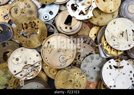 Close up of a selection of vintage clockworks at a flea market. - Stock Photo