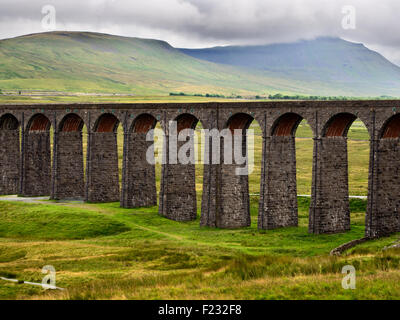 Arches of the Ribblehead Viaduct with Ingleborough Shrouded in Cloud Yorkshire Dales England - Stock Photo