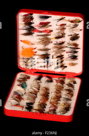 box of fly fishing flies on black background - Stock Photo