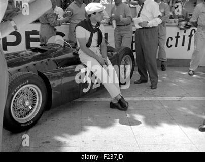 Castellotti sitting on his Lancia D50 in the pits, Monaco GP Monte Carlo 1955 - Stock Photo