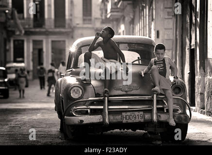 Cuban kids on a classic American car. CHEVROLET. A cultural icon for modern day Cuba. Havana, Cuba. - Stock Photo