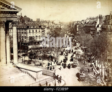 Antique photograph of the Boulevard de la Madeleine, Paris, filled with horses and carriages, in the late 19th Century - Stock Photo