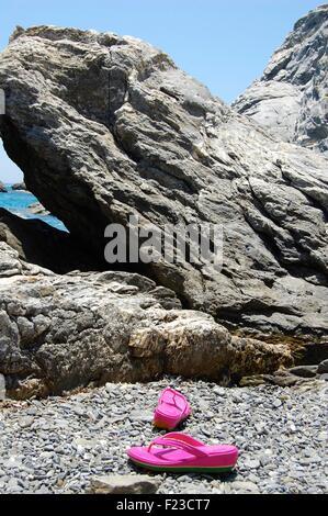 Pink flip flops on the beach at Agia Anna Amorgos, Greece - Stock Photo