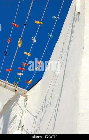 colored plastic pegs on a washing line in Amorgos Greece - Stock Photo