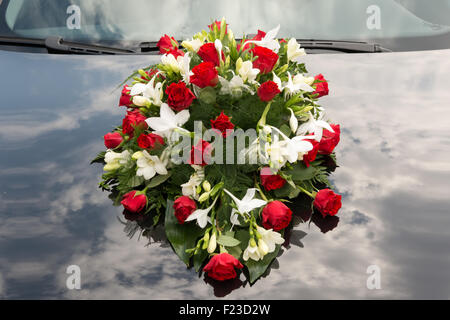 Wedding bouquet on car - Stock Photo