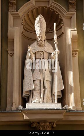 A statue graces the exterior of the Nice Cathedral (Basilique-Cathédrale Sainte-Marie et Sainte-Réparate de Nice). - Stock Photo