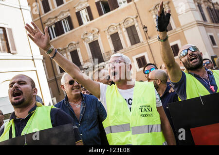 Italian taxi drivers shout slogans during a demonstration to protest against Uber service in Rome. Hundreds of Italian - Stock Photo