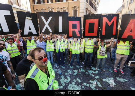 Italian taxi drivers hold placards reading 'Rome Taxi' during a demonstration to protest against Uber service in - Stock Photo