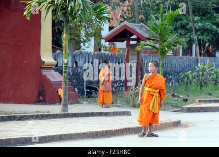 Lao novice monks in saffron robes Luang Prabang, Laos - Stock Photo